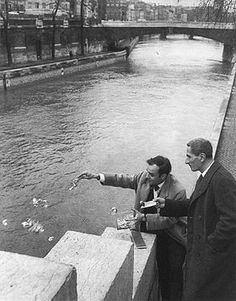 Yves Klein and Dino Buzzati engaged in the ritual transfer of immateriality, January 26, 1962