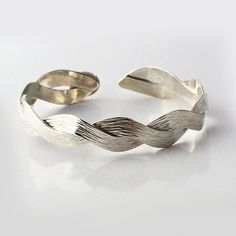 This bracelet is a flexible sterling silver cuff with a cross peen horizontal hammer texture. The natural look and comfortable fit make it