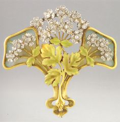 An Art Nouveau platinum, gold, enamel and diamond brooch pendant, circa 1902.
