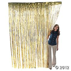 Metallic Gold Fringe Curtains from oriental trading company for backdrop of photo booth $6.50