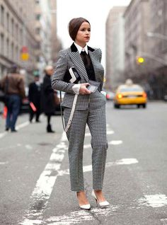 Miro Duma wears spring's white pumps trend with a well-tailored suit.    New York Fashion Week Street Style - Harper's BAZAAR