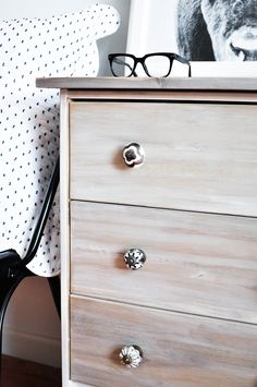 """Featured in this post are details for the best Ikea """"Rast"""" hack featuring  whitewashed wood, Anthropologie knobs, a driftwood stain and bun feet to  give the Rast the perfect nightstand makeover."""