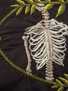 Hand-embroidered skeleton motif on clothing. #memento mori