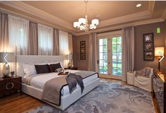 The wall color is called Poised Taupe SW 6039 by Sherwin Williams and the ceiling is Macadamia.