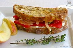 Vegetarian Panini with Roasted Peppers and Goat Cheese - This crispy Italian sandwich is made with oven roasted peppers instead of commercially made bell peppers. I like to roast several peppers at time and use in homemade tomato paste and marinara. #sandwichrecipes