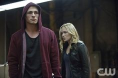 """Arrow -- """"The Promise"""" -- Image AR215a_0208b -- Pictured (L-R): Colton Haynes as Roy Harper and Caity Lotz as Canary -- Photo: Cate Cameron/The CW -- © 2014 The CW Network, LLC. All Rights Reserved."""