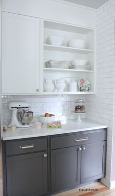 White top and gray bottom cabinets w/white subway tile; don't like the white countertop though.
