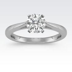 Let the center stone of your choice sparkle and shine with this cathedral solitaire engagement ring crafted in superior platinum.