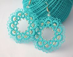 Tatting lace earrings turquoise and sterling silver beads. Made with the technique of needle tatting, the beads were inserted during processing are