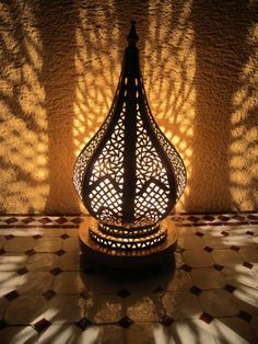 This beautiful floor lamp made of brass is a masterpiece of oriental craftsmanship. If you want to give your home a special touch, this gem is just right for you. Warm colors have a positive effect on our mood, so do something for your well-being and get that dream out of 1001 nights in your home. Moroccan Floor Lamp, Moroccan Ceiling Light, Moroccan Pendant Light, Moroccan Lighting, Brass Pendant Light, Moroccan Lanterns, Copper Lamps, Wood Lamps, Indoor Candle Lanterns