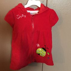 Toddler red lady bug cover up The perfect cover up for your toddler before and after a swim. Zip up with hood to keep the fashionista dry and protected from the sun. Wippette Other