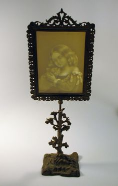 Antique Victorian Original Painted Cast Iron Table Adjustable Face Fire Screen With Lithopane Depicting A Girl Holding A Cat      c. 1870's