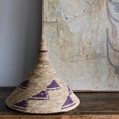 """The traditional Rwandese basket has a conical top and """"zigzag"""" geometric designs. These make perfect art objects to display! #basket #globalstyle #homedecor"""