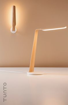 Swan by Tunto - combination of traditional woodwork with new Osram OLED light…