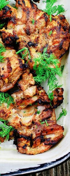 Get this easy Mediterranean recipe! Mediterranean Grilled Chicken + Dill Greek Yogurt Sauce! Chicken thighs marinated in Mediterranean spices, garlic, lemon and olive oil sauce. Grills perfectly in 15 minutes! Every bite with a dollop of the dill yogurt sauce is simply bliss!
