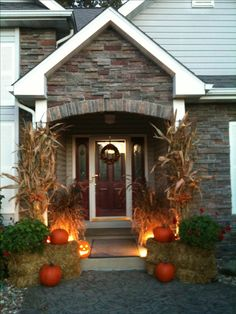 Love the face of this house, love the Corn Stalks and Pumpkins...love love love!!