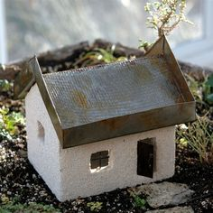 """The Tabby Cottage with Living Roof is 7"""" high x 7"""" wide x 5 deep. The detachable roof has drainage holes and can be planted with shallow rooted plants such as miniature hens and chicks."""