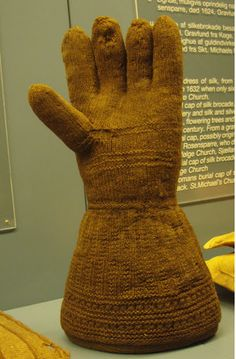 Considerable research activity in historical knitting groups has taken place recently and some interesting finds have turned up, mainly on the continent. It is becoming clear that woollen gloves and mittens were worn by the less well off during our period.  Fine leather gloves and embroidered gauntlets were more often the preserve of the upper echelons, although leather mittens may have been used for protection, perhaps when hedge laying or performing similar tasks that involve working with…