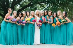 Turquoise Bridesmaids Dresses!- love how it goes with the white! with purple bouquets?