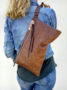 ~~ Oversized leather clutch . Everyday clutch . Zip and hand strap. Leather bag has gold colored shadow .  Dark Ostrich clutch . Dark chocolate leather