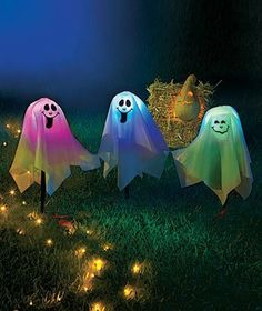 """Set of 3 Color-changing Ghost Stakes by LTD. $17.88. A color-changing ball hides under the fabric of the Set of 3 Color-Changing Ghost Stakes to create a whimsical display of red to green to blue. They're battery operated, too! These charming Halloween stakes are printed with friendly ghost faces and stand 16-1/4"""" tall including the 5"""" stake that goes into the ground. They're connected together and conveniently share the same battery compartment so you can stick them anywhere! Re..."""
