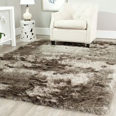 Soft, plush and luxurious, Safavieh's Paris Shag Rug evokes the classic understated elegance and neutral color palette of French Moderne style. The drama of these rugs is in their lush opulent texture