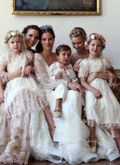 The Baroness Cleopatra von Adelsheim von Ernest with her maids of honor, Princess Isabella Gaetani von Lobkowicz and Countess Beatrice Borromeo Casiraghi, and the flower children.
