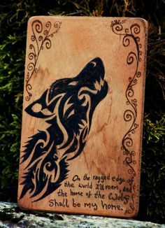 "Wolf Wood Burning, by Norseman Arts.  ""On the ragged edge of the world I'll roam, and the home of the wolf shall be my home.""  ~ Robert Service"