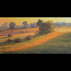 Oil paint on linen using the Old Masters style of glazing thin oil colors over a detailed drawing. The time of day is early morning as the sun rises over a field of hay bales.