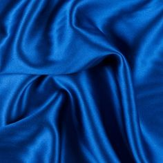 Mood's silk crepe-back satin is a medium-weight silk with a crepe face and a satin face. It has an exquisite drape and a lovely sheen, and makes sumptuous dresses, blouses, skirts and special occasion garments. Available in 96 attractive shades. Silk Crepe, Silk Satin, Blue Fabric, Silk Fabric, Shades Of Blue, Red And Blue, Mood Fabrics, Sewing For Beginners, Fashion Fabric