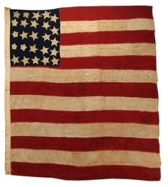 This American Flag is one of the earliest examples of the American flag known to exist.  There are perhaps a dozen or so stars and stripes that are reasonably attributable to the era of the War of 1812 or earlier, and this is one of them. 19 Stars (1816-1817) Updated to 25 Stars (1836-1837) Wool Bunting and Linen, hand stitched (later treadle machine reinforced)