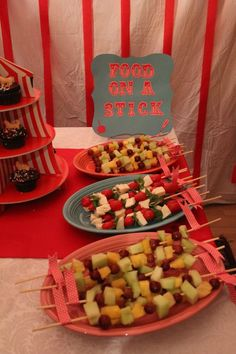 LOVE the fruit kabobs and the tent circus tent cupcake stand