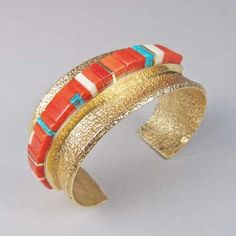 Charles Loloma 18k Gold Tufa Cast Bracelet with Coral Height Inlay. Material: 18k gold, coral, turquoise and fossilized ivory