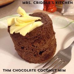 THM Chocolate COCONUT MIM 2 tbsp butter melted 1 tbsp coconut flour 1 tbsp cocoa 1 egg 1/2 tsp baking powder 1/4 tsp gluc 1 or 2 tsp vanilla extract 10 or more drops of liquid stevia or 1/2 to 1 tsp THM Sweet Blend (taste) A sprinkle of salt Spray a coffee mug well. Melt butter for 30 sec. Add all ingredients (egg last). Mix well. Microwave for 1 min. Dump out.