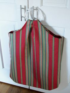 Laundry bag--made mine from an old pillowcase and used shower curtain rings rather than purchasing purse handles. Recycle!!!