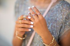 Layered rings & white manicure