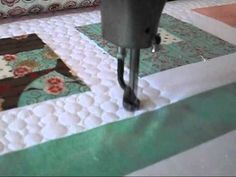 Machine quilting pebbles!!  Into my faves... YouTube
