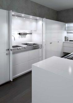 Une cuisine high-tech - Une cuisine ouverte qui se cache - CôtéMaison.fr