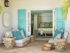 Shades of aqua and seafoam create a luxurious island atmosphere for this master bedroom.  The bed faces pocket doors that open to the pool terrace and a private, intimate sitting nook.