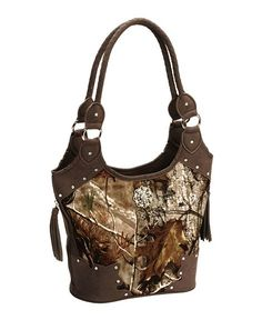 """#RealtreeAP Print Hobo #camoHandbag -This fashion-forward purse boasts a brown faux leather with Realtree AP camo fabric. Hobo bag features a secure zipper closure at top and two exterior zip pockets with tassels. Interior boasts inside zip pocket and two slip pockets. Silver-tone metal feet at bottom. Handbag measures 13 1/2"""" x 13 1/2"""" x 6"""". Imported."""