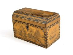 A Regency penwork tea caddy, chinoiserie decorated with figures in oriental landscapes, the interior with twin lidded compartments, 4¾in (12.2cm) high, 7½in (18.6cm) wide. 4½in (11cm) deep.