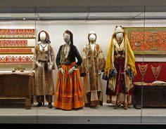 L to R: (1) Country costume of Cyprus (2) City costume of Cyprus (3) Chemise with raised embroidery, from Karpathos (4) Bridal costume from Astypalaia, Dodecanese @ Benaki Museum, Athens [http://stitchopolis.blogspot.sg/2014/02/athens-day-5-benaki-museum-textiles.html; http://thierry.jamard.over-blog.com/article-athenes-musee-benaki-31-mars-et-2-avril-2011-75609151.html; http://attica.unipi.gr/culture/article.php?article_id=110&lang=en]