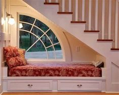 It doesn't get much cozier than an under-the-stairs bench-style reading nook with its own unique window.