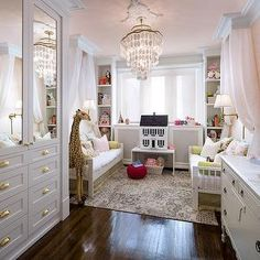 daybed canopy, dolls house, white side table, bookcases flanking window, bookshelves flanking window, window bookcases, window built-ins, built-in bookcases, built-in bookshelves, toddlers room, twin toddlers room, twin toddler girls room, pink ceiling, pink ceiling, nursery ceiling, nursery with pink ceiling, nursery wallpaper, mirrored doors, kids daybed, ivory and gray rug, yellow lamp, french dresser, nursery closets, kids bed canopy, girls bed canopy, pink and gray nursery, girls…