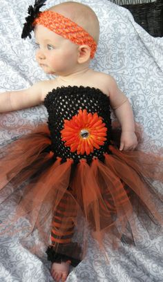 Baby/ Infant Girl Halloween Costume Crochet Black and Orange Dress with Orange Flower comes with Matching Leggings/ leg warmers. $23.95, via Etsy.