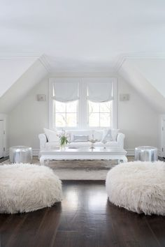 Love this white and barely pink room ....