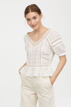 Short blouse in airy, pattern-weave cotton with inset lace sections and a V-neck front and back with a wide lace trim. Dropped shoulders and short raglan sl White Cotton Blouse, Cotton Blouses, Cotton Lace, Shirt Blouses, Cheap Blouses, Blouses For Women, Blouse En Coton, Beautiful Blouses, Fashion Clothes