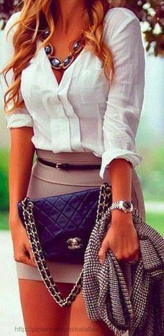 Adorable mini skirt with white shirt and Coco Chanel handbag