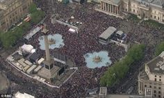 An estimated 10,000 people were packed into Trafalgar Square to watch the ceremony on a giant screen.