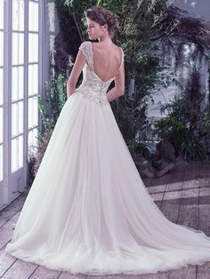 Maggie Sottero - BEVERLY, Swarovski crystals, pearls, and embroidered lace adorn the fitted bodice and sweetheart neckline before flowing into a dreamy tulle ball gown skirt. Finished with covered buttons over zipper and inner corset closure. Detachable embellished cap-sleeves sold separately.